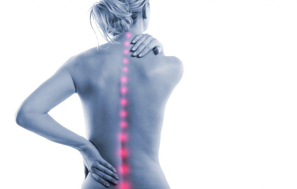 Frau mit Rckenschmerzen Punkten
